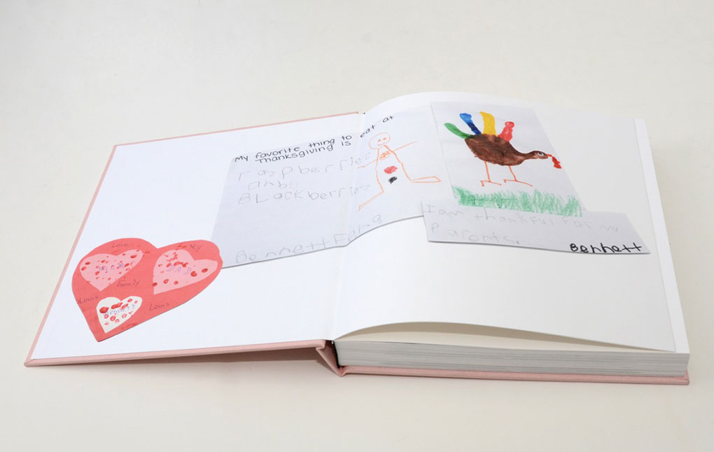 A custom printed end sheet in a NY Madison-style family yearbook by Couture Book