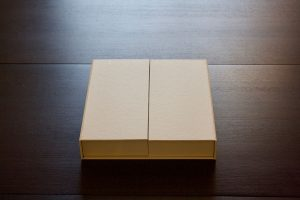 Couture Book's elevated presentation box with flaps closed