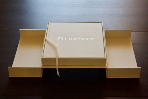 Couture Book's elevated presentation box fully opened