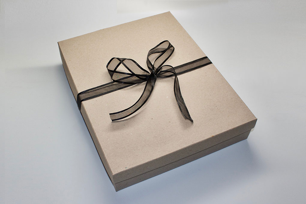 The new Couture Book gift box with a black ribbon