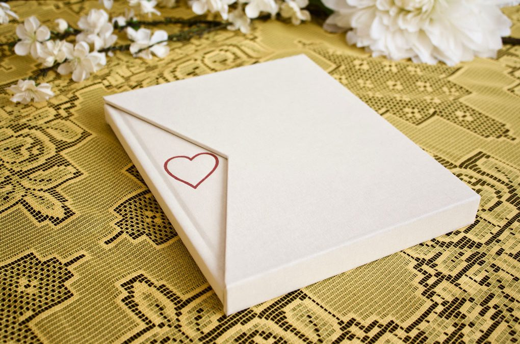 This NY Madison has an angled-edge slipcase and a custom stamp with rose gold foil.