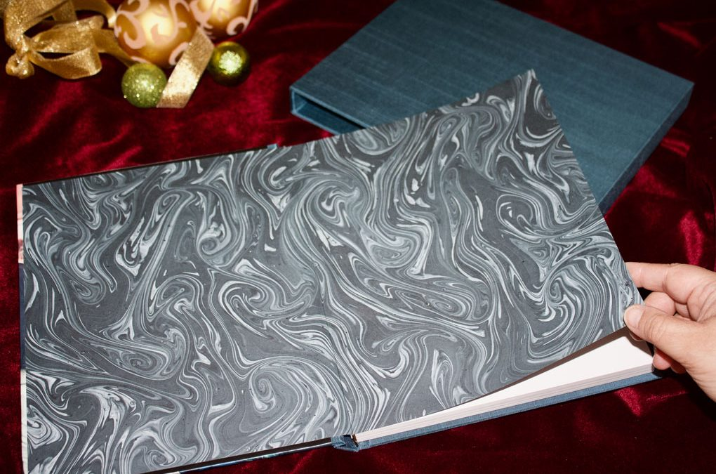 Couture Book with a blue marbled custom end sheet